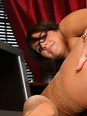 Secretary Lilly in glasses strips to her tan holdups for some office fun.