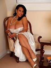 Danica poses in her full length silk nightdress before peeling it off