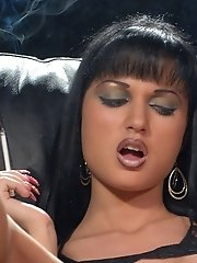 Roxanna and Karen Wood smoke all white 100's slims cigarettes while getting naughty. The girls start to kiss and lick while smoking and pay extra