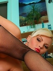 Sandra in fishnet stockings and high heels