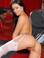 Dark haired beauty in naughty, purple lingerie, white stockings and strappy heels.